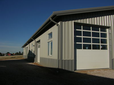 Options for commercial overhead doors and garage doors for Garage roofing options